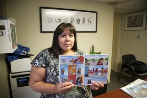 Lisa Jackson displays a comic book produced by the Association of Iroquois and Allied Indians, which will be launched at the Forest City Comicon. (DEREK RUTTAN, The London Free Press)