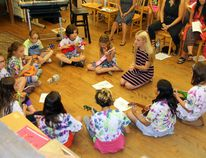 In August, the Ottawa Valley Music School hosted its Camp Harmony, when on three separate weeks their students had the chance to enjoy themselves while sharpening their musical skills. At the end of each week, the campers put on a wrap up concert to show everyone what they had learned. In the ukulele circle is teacher Merranda Leeck, and counterclockwise there is Jadyn Malone, Leland LaPierre, Kamala Ellis, Georgia Holt, Annalise Knight, Avery Trader, Taiha McKinnon, Kya Ellis, Catalina Solis, and Abby Knight. Missing from the photo is Alice Chubak.