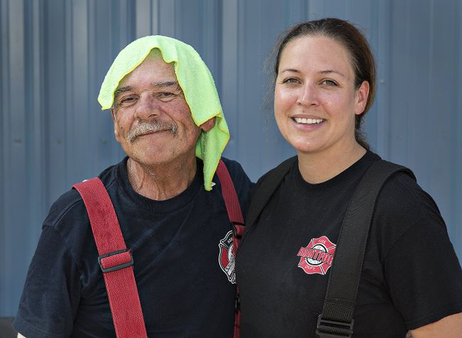 Brian Thompson/The ExpositorFirefighter for a Day participant Joe Bomberry of Simcoe stands with Anna Everett, assistant training officer for the Brantford fire department, at a fire suppression training facility on Six Nations.