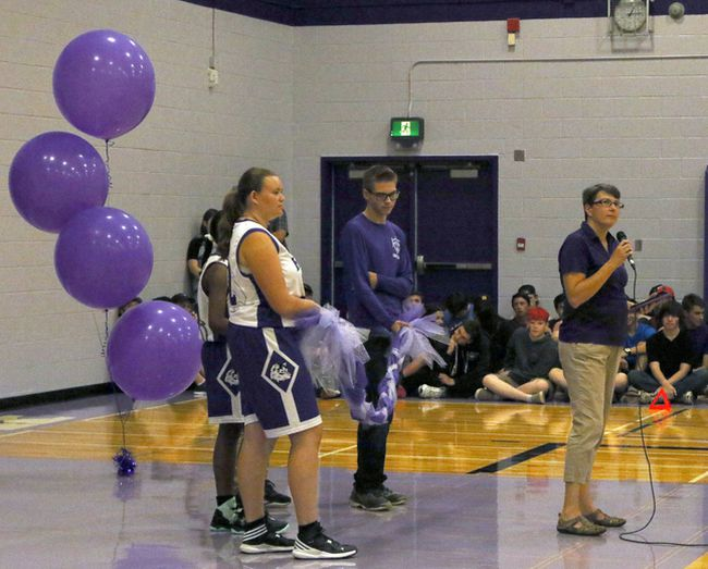 Huron Park's principal Christine Sharpe, right, gives opening statements before the ribbon cutting for the school's new gym floor in Woodstock, Ont. at Huron Park on Tuesday September 19, 2017. The Huskies won 34-30. Greg Colgan/Woodstock Sentinel-Review/Postmedia Network