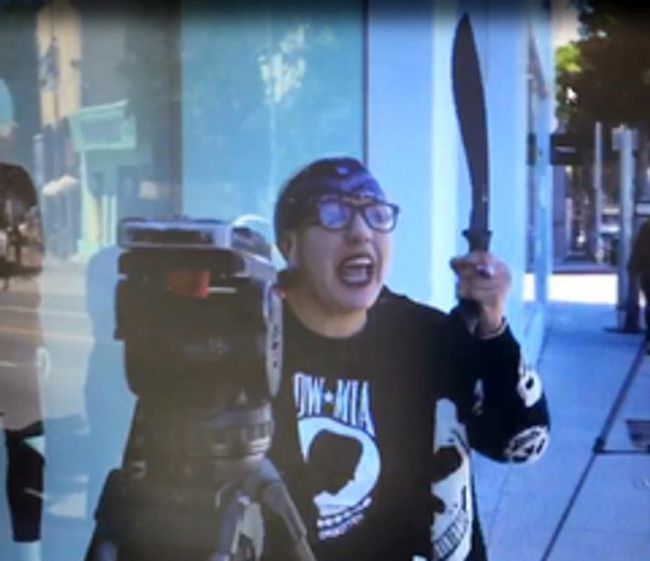 In this Thursday, Sept. 21, 2017, video image released by the Los Angeles County Sheriff's Department, a suspect waves a machete at news reporters outside the Kardashian-owned DASH boutique in West Hollywood, Calif. (Los Angeles County Sheriff's Department via AP)