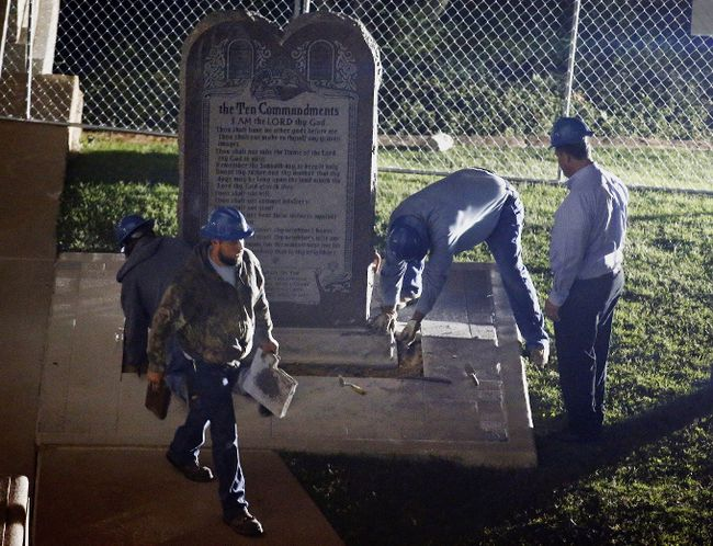 <p>Workers remove a 10 commandments monument from its base on the grounds of the State Capitol in Oklahoma City on Oct. 5, 2015. The monument was removed after the Oklahoma Supreme Court's decision it violated a state constitutional prohibition on the use of public property. </p><p>