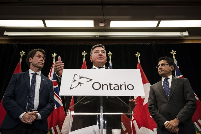 <p>Ontario Minister of Finance, Charles Sousa, centre, Attorney General, Yasir Naqvi, right, and Minister of Health and Long-Term Care, Eric Hoskins speak during a press conference where they detailed Ontario's solution for recreational marijuana sales, in Toronto on Friday, September 8, 2017. </p><p>