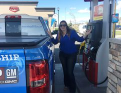 Jazminn Hintz gets ready to fuel up her truck at the Calgary Co-op's Railway Gate location in Airdrie during the Calgary Co-op's Fuel Good Day on Tuesday, Sept. 19, 2017.