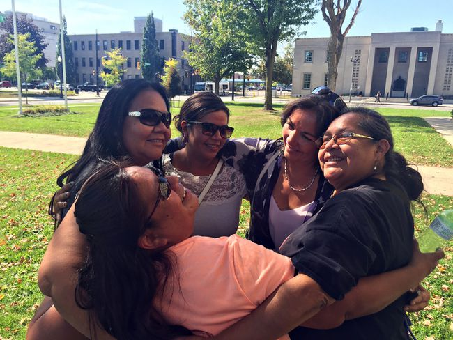 Michael-Allan Marion/The ExpositorSix Nations farmer Kris Hill (second from right) takes part in a group hug on the front lawn outside Superior Court on Friday afternoon following a judge's ruling that will see her evicted from the Burtch lands.