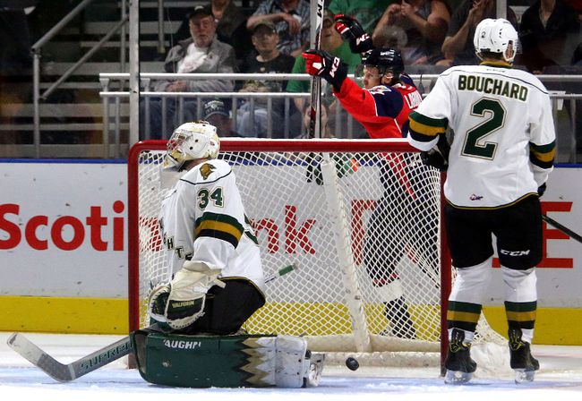 Igor Larionov of the Spitfires tipped a shot behind Knights goaltender Tyler Johnson for the first goal of the game at Budweiser Gardens on Friday September 22, 2017. At the end of the first the game was tied up at 1-1.Mike Hensen/The London Free Press/Postmedia Network