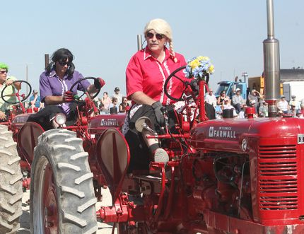 The Team Farmall Dancing Tractors showcased their tractor dancing skills while having some fun dressed up like women. (Shaun Gregory/Huron Expositor)