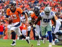 Denver Broncos' Quarterback Trevor Siemian scrambles against the Dallas Cowboys in the third quarter of a game at Sports Authority Field at Mile High on Sept.17, 2017 in Denver, Colo. (Dustin Bradford/Getty Images)