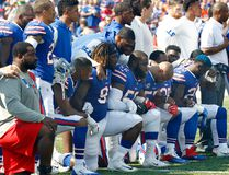 Buffalo Bills players take a knee during the playing of the national anthem prior to an NFL game against the Denver Broncos in Orchard Park, N.Y., on Sunday, Sept. 24, 2017. (Jeffrey T. Barnes/AP Photo)