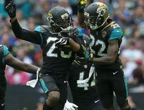 Jaguars cornerback Jalen Ramsey (centre left) celebrates after intercepting a pass with cornerback Aaron Colvin (22) during the second half of NFL action against the Ravens at Wembley Stadium in London on Sunday Sept. 24, 2017. (Tim Ireland/AP Photo)