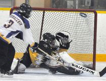 Despite the best effort of Mitchell U16AA goaltender Rachel Van Bakel, Whitby's Hailey Cornacchia (3) flips the ring high into the net while on a power play during first half action last Saturday, Sept. 23. Mitchell rebounded to take a 3-1 halftime lead but couldn't hold it in a 3-3 draw. ANDY BADER/MITCHELL ADVOCATE