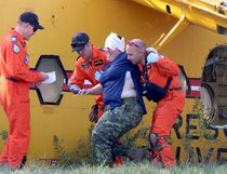 Bruce Bell/The Intelligencer A victim of the simulated air crash is helped from a Buffalo aircraft.