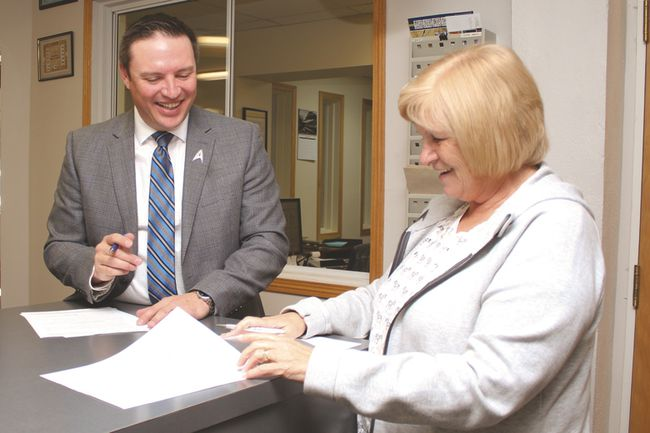 Georgia-Lee DeBolt submits Sept. 18 her nomination forms for another term as a Town councilor to Kim Fath, the Town's administrator.
