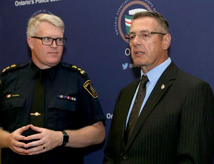 Bryan Larkin, left, Waterloo Region Police chief and president of the Ontario Association of Police Chiefs, and Kingston Police Chief Gilles Larochelle at an association meeting at the Four Points by Sheraton in Kingston on Monday. I(an MacAlpine/The Whig-Standard)