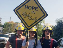 Norfolk Fire Services members Bryn Thomson (left), Marco Reyes and Justin Sega show off their red high heels before the start on Saturday of the second annual Hope in High Heels fundraiser for Haldimand and Norfolk Women's Services, held in Simcoe. (Michael-Allan Marion/The Expositor)