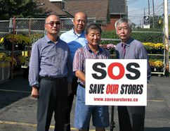 James Oh (left), president of the Ontario Korean Businessmen's Association, business development manager Sunny Chon, Mom's Variety owner William Bae and association general manager Don Cha stand out front of Mom's Variety on St. George Street on Monday to deliver a statement about problems facing their industry. (Michael-Allan Marion/The Expositor)