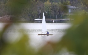 A sailor makes his way across Ramsey Lake in Sudbury, Ont. on Monday September 25, 2017. Temperatures will cool to more seasonable temperatures by week's end. Gino Donato/Sudbury Star/Postmedia Network
