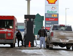 FILE PHOTO - Motorists fuel up at a gas station on Calgary Trail in 2014. The Alberta Federation of Labour is asking the provincial government to institute pay-at-the-pump laws which, it says, would protect gas-station workers from violence and cut down on theft.