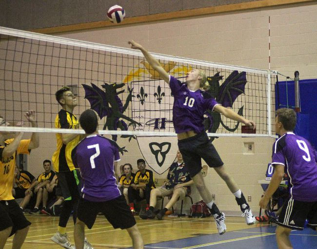 Ben Haley of L'Heritage tips the ball over the net during senior boys volleyball action against CCVS at L'Heritage on Tuesday. The host Dragons won all six of their games. Kevin Gould/Cornwall Standard-Freeholder
