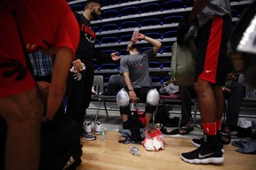 Toronto Raptors players ice their knees and quench their thirst during training camp at the University of Victoria in Victoria, B.C., on Sept. 26, 2017. (THE CANADIAN PRESS/Chad Hipolito)