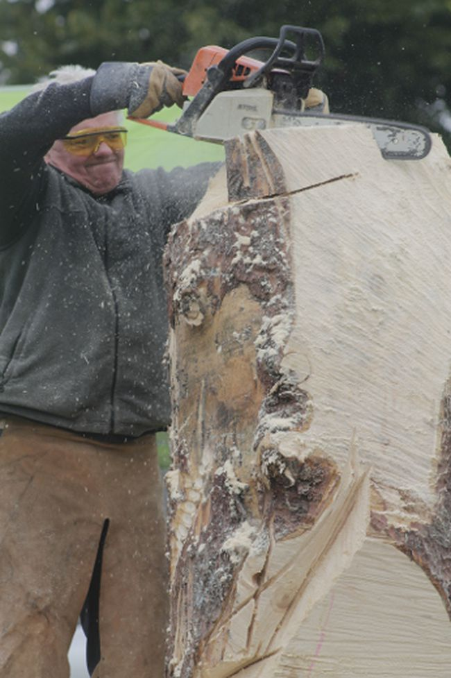 Viktor Kacperski carves into a block of wood with a chainsaw in a display at the Blue Ridge Logging Days on Sept. 23 (Joseph Quigley | Whitecourt Star).