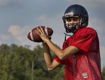 Assumption College quarterback Brandon Caputo looks to make a pass during a practice for the high school senior football team. (Brian Thompson/The Expositor)
