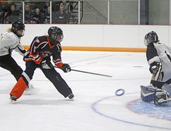 The U14AA Rusty Ring Ringette Tournament took place Sept. 22-24 in Cochrane at the Spray Lakes Arena. Here, the Zone 2 team (blue and orange) faced zone 5 on Sept. 23. Zone 2 comprises the Strathmore, Indus, Airdrie and Cochrane ringette associations.