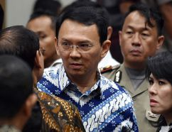 """Jakarta Governor Basuki """"Ahok"""" Tjahaja Purnama, center, talks to his lawyers after his sentencing hearing at a court in Jakarta, Indonesia, Tuesday, May 9, 2017. An Indonesian court on Tuesday sentenced the minority Christian governor of Jakarta to two years in prison for blaspheming the Quran, a shock decision that undermines the country's reputation for practicing a moderate form of Islam.(Bay Ismoyo/Pool Photo via AP)"""