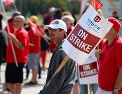 Pickets walk the line outside the strikebound Cami car factory in Ingersoll Thursday, as the focus in the strike by 2,800 workers shifted to getting top executives in General Motors in Detroit involved in the stalemate. (BRUCE CHESSELL, Woodstock Sentinel-Review)