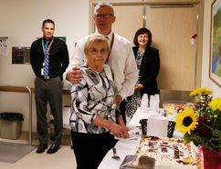 Pat Wounch, one of the first patients of the Woodstock dialysis unit, cuts the cake celebrating the 20th anniversary of the Woodstock Hospital's dialysis unit on Thursday. (BRUCE CHESSELL/Sentinel-Review)