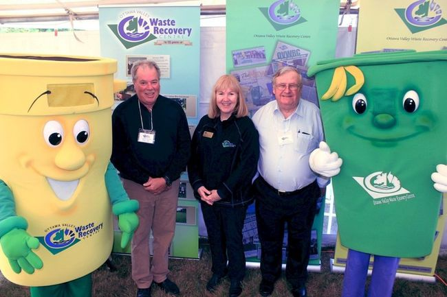 Sean Chase/Daily Observer The Ottawa Valley Waste Recovery Centre (OVWRC) celebrated 15 years of providing waste processing services to local municipalities on Saturday with an open house. In the photo are (left to right) Toby the Triple R Can, Laurentian Valley Mayor Steve Bennett, chairman of the OVWRC management board, OVWRC executive director Sue McCrae, Public Liaison Committee member William Halkett and Curby the Green Cart.