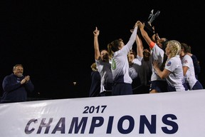 FC London women?s team players celebrate with the trophy after clinching first place in League1 Ontario on Saturday in Mississauga, the team?s second straight championship. (League1 Ontario/Martin Bazyl Photography)