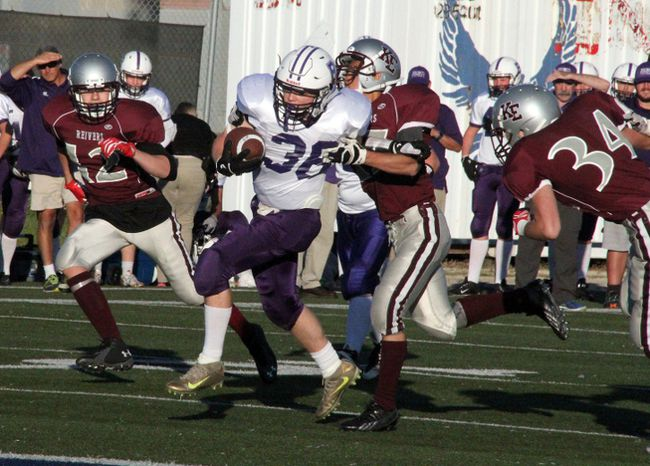 Clark Boucha fends off the Kildonan East Reivers defenders on his way to the end zone for six points to give the Beaver Brae Broncos a 28-0 advantage, during the Winnipeg High School Football League game, Friday, Sept. 29 at Eastside Eagles Field in Winnipeg. The Broncos went on to win 48-14 and are tied for first place at 4-0 in the Andy Currie Division (A) with the Daniel Mac Maroons. SHERI LAMB/Daily Miner and News/Postmedia Network