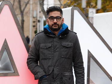 MC Aurangzeb Qureshi poses for a photo before the Stand Together Against Violence in Solidarity with EPS vigil organized by Alberta Muslim Public Affairs Council at Churchill Square in Edmonton, Alberta after a police officer and four bystanders were injured in a terrorist attack on Sunday, October 1, 2017. Ian Kucerak / Postmedia