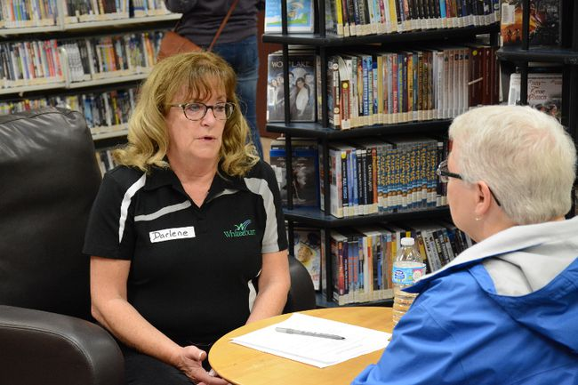 Mayoral candidate Darlene Chartrand talks with a resident during a Human Book event at the Whitecourt and District Public Library on Sept. 30 (Peter Shokeir | Whitecourt Star).
