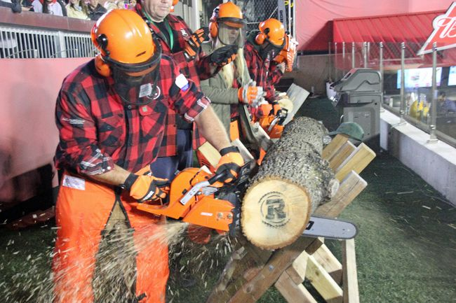 Once it was announced that the Ottawa Redblacks scored a touchdown, the Algonquin Loggersports team got to work with Taylor Popkie at the helm as he revved up his chainsaw and began cutting off a celebratory 'wooden cookie' as a cloud of sawdust sprayed around him and thousands of Redblacks fans cheered him on.