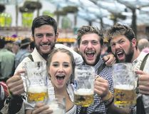 Revellers in Munich, Germany, raise their mugs to Oktoberfest. (Special to Postmedia News)