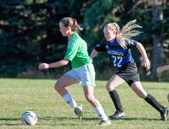 Canmore Crusaders player Lauren Gray keeps the ball from Highwood player Capri McKinnon during their game at Millennium Park in Canmore on Thursday, September 28, 2017. photo by Pam Doyle/www.pamdoylephoto.com