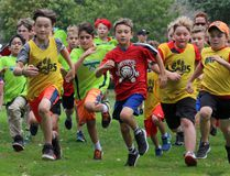 Runners head into the first turn in the Grade 5 boys race.