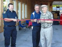 Saugeen Shores Fire Chief Phil Eagleson (left), Mayor Mike Smith and former Southampton Fire Chief Doug Huber officially cut the ribbon to open the new Antique Fire Truck Hall Oct. 3 at the Southampton Fire Hall on Victoria St. Frances Learment/Shoreline Beacon