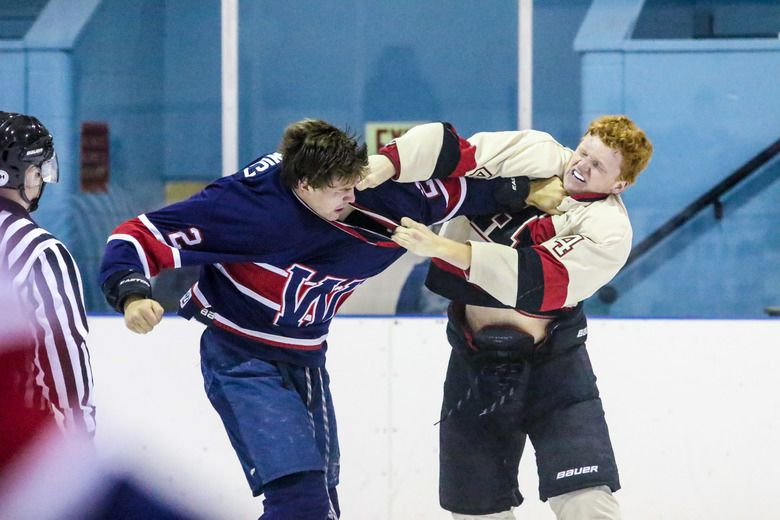 Wetaskiwin�s Reid Pankewicz and Fort Saskatchewan�s Mike Gaumont trade punches during a third period fight in Sunday night Capital Junior Hockey League action.