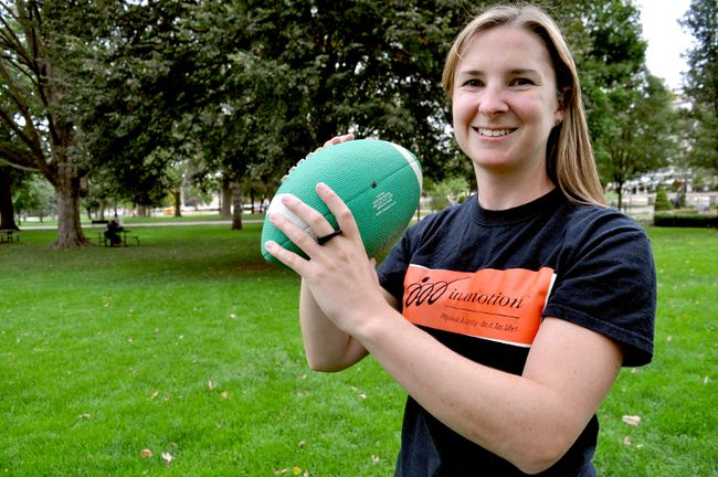 Karen Dillane, a City of London recreation supervisor, holds a football in Victoria Park. The ParticipAction 150 playlist makes a stop in London Oct. 11 during the in motion Community Challenge, an annual campaign that encourages Londoners to get moving through physical activity. (CHRIS MONTANINI, Londoner)