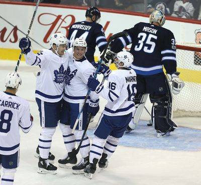 WINNIPEG, MANITOBA - OCTOBER 4: Forward James van Riemsdyk #25, forward Tyler Bozak #42 and forward Mitchell Marner #16 of the Toronto Maple Leafs celebrate Van Riemsdyk's goal against the Winnipeg Jets during NHL action on October 4, 2017 at the Bell MTS Centre in Winnipeg, Manitoba. (Photo by Jason Halstead /Getty Images)