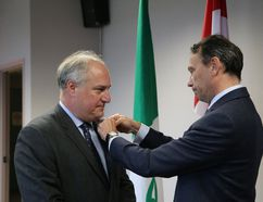 John Lappa/Sudbury Star/Postmedia Network Marc Trouyet, right, Consul General of France in Toronto, bestows the Knight in the Order of the Academic Palms of the French Republic to Pierre Riopel during a ceremony in Sudbury on Thursday. Riopel is the former president of College Boreal.