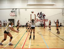 In senior girls' volleyball action, the Bow Valley Bobcats defeated the W.H. Croxford Cavaliers 3-2 in a back and forth match.