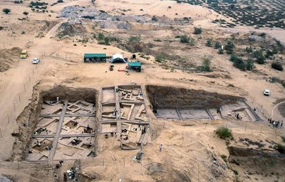 In this undated image taken in 2000, provided by the Palestinian Department of Antiquities, an aerial view of the excavations at Tel Es-Sakan, shows houses dating to 2600-2300 B.C., left, and fortifications from the late fourth millennium B.C, south of Gaza City. (Pierre de Miroschedji/Palestinian Department of Antiquities, via AP)