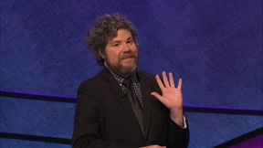 """In this undated handout photo provided by Jeopardy Productions, Inc., Austin Rogers waves during a taping of """"Jeopardy!"""" in Culver City, Calif. Rogers, a New York City bartender, extended his run of wins to eight on the show that aired Oct. 5, 2017, and boosted his total winnings to more than $300,000. (Jeopardy Productions, Inc. via AP)"""
