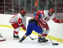 Kenora Thistles forward Jake Clendenning (#14) tries to keep control of the puck while being checked by a Norman Northstars player during the Manitoba Midget AAA Hockey League home opener at the Kenora Recreation Centre, Saturday, Sept. 30. SHERI LAMB/Daily Miner and News/Postmedia Network