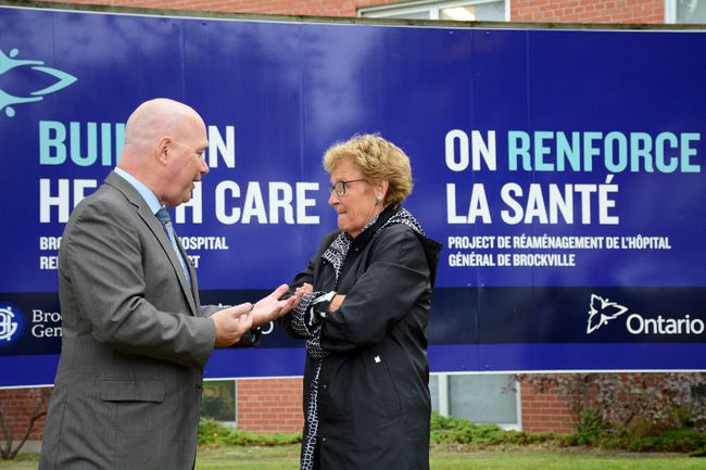 Leeds-Grenville MPP Steve Clark speaks to Joan Simon, executive director of the Brockville and District Hospital Foundation, after the unveiling of a sign marking Brockville General Hospital's coming multimillion-dollar expansion in this October file photo. (SABRINA BEDFORD/The Recorder and Times)