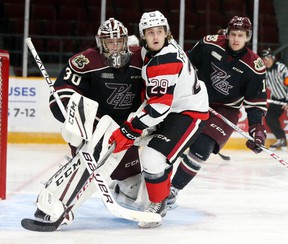 67's forward Tye Felhaber gets tangled up with Petes netminder Dylan Wells during Friday's OHL game at TD Place arena.